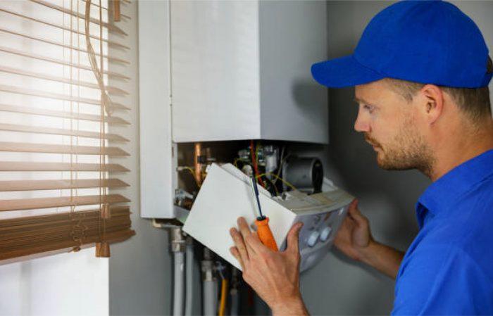 Plumber Opening Water Heater